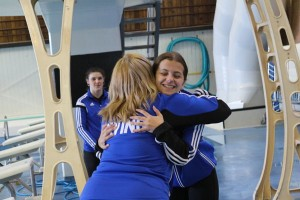 Carmen Landry receives her placement and a hug from Head Coach, Amanda Layton-Malone.