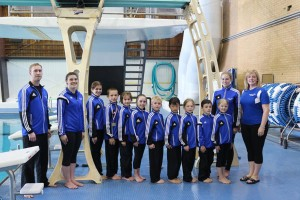 The team on day two of competition. Our youngest athlete is just six years old!  Our newest coach, Madeline Whitehouse had her very first experience coaching at a competition.