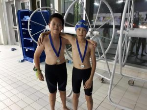 Daniel and Enoch with their medals