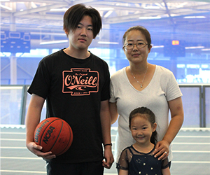 mom, son with basketball and daughter on the Track